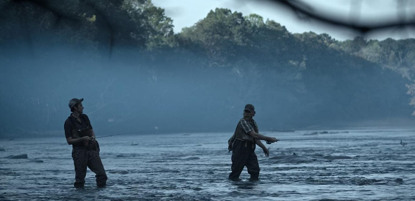 screencap from ozark tv show: two anglers in waiters cast into river