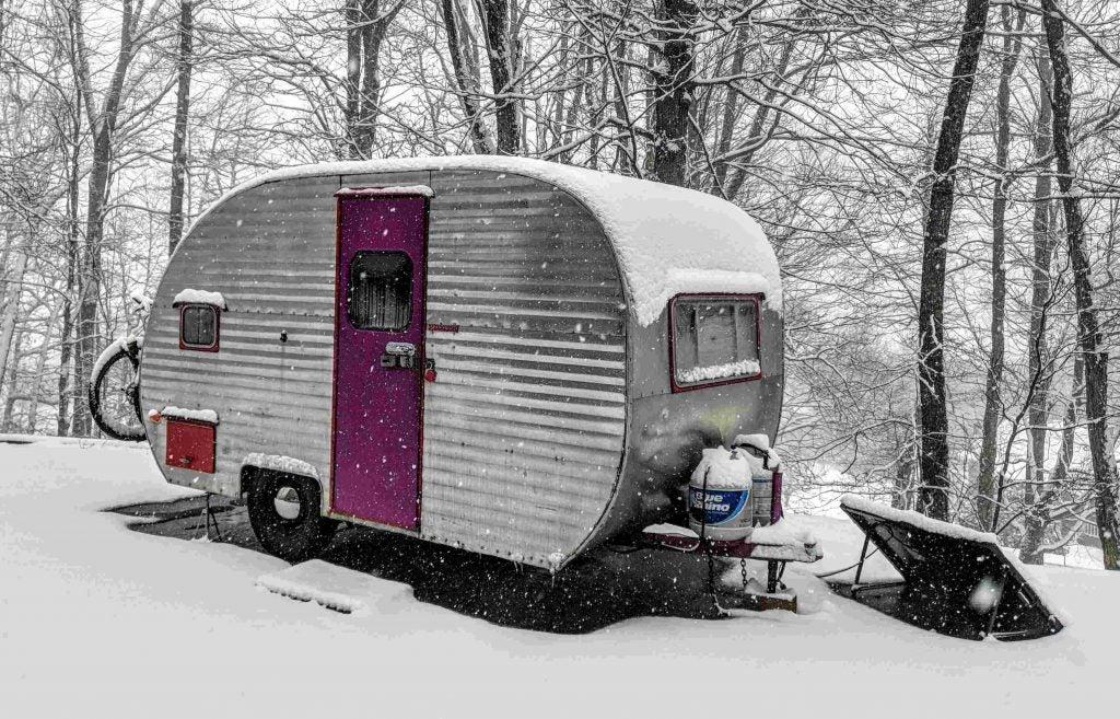 canned ham camper sits at a campsite in a North Carolina snowstorm