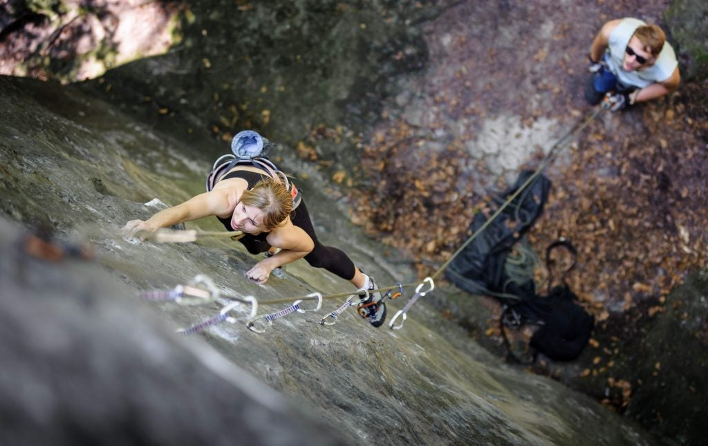 female climber attempts to scale the pictured rocks in iowa