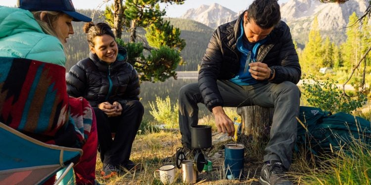 group of friends utilize their gifts for backpackers on the trail