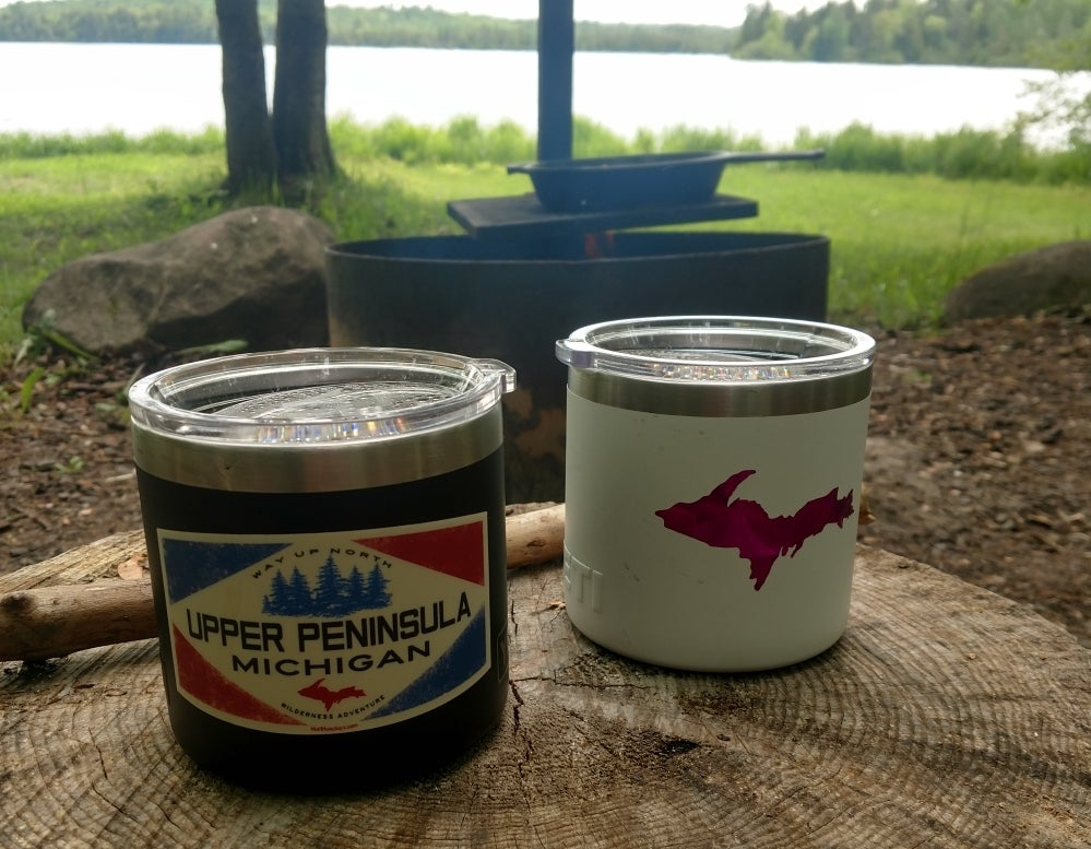 insulated yeti containers used for Geocaching, covered in Michigan stickers