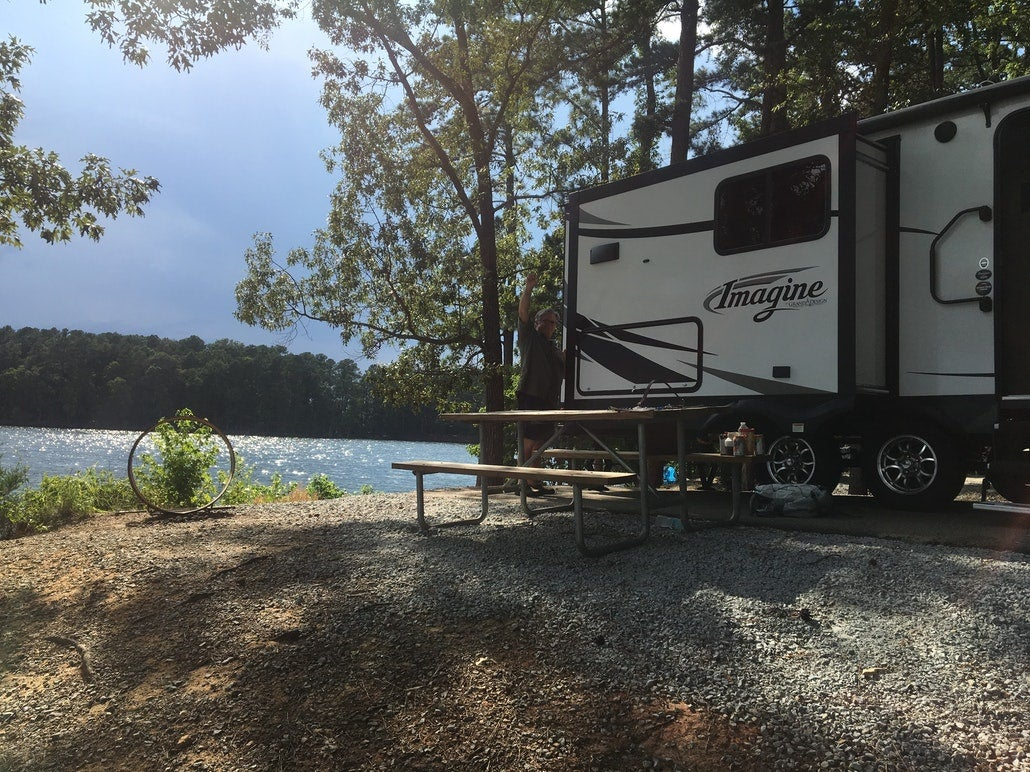 an rv resting at a campsite at dreher island state park