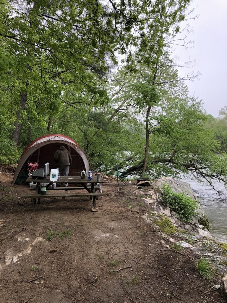 a tent on the shore of a river in north carolina