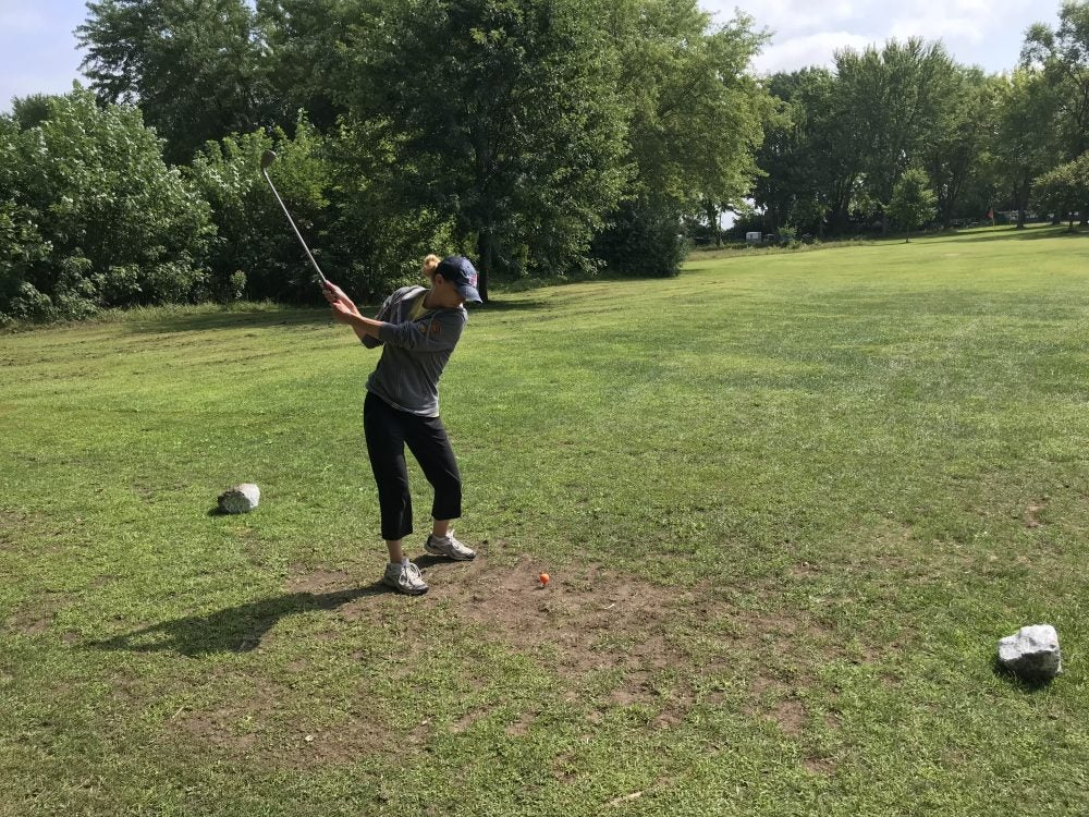Woman golfing at LeFleur's Bluff State Park
