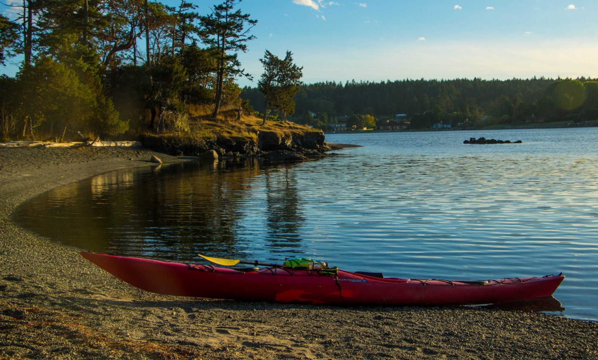 Kayak sits on shore of on of the San Juan islands