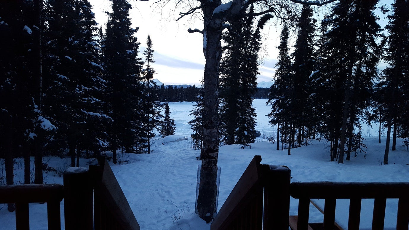 snowy winter view from the porch of a cabin in kenai fjords national park