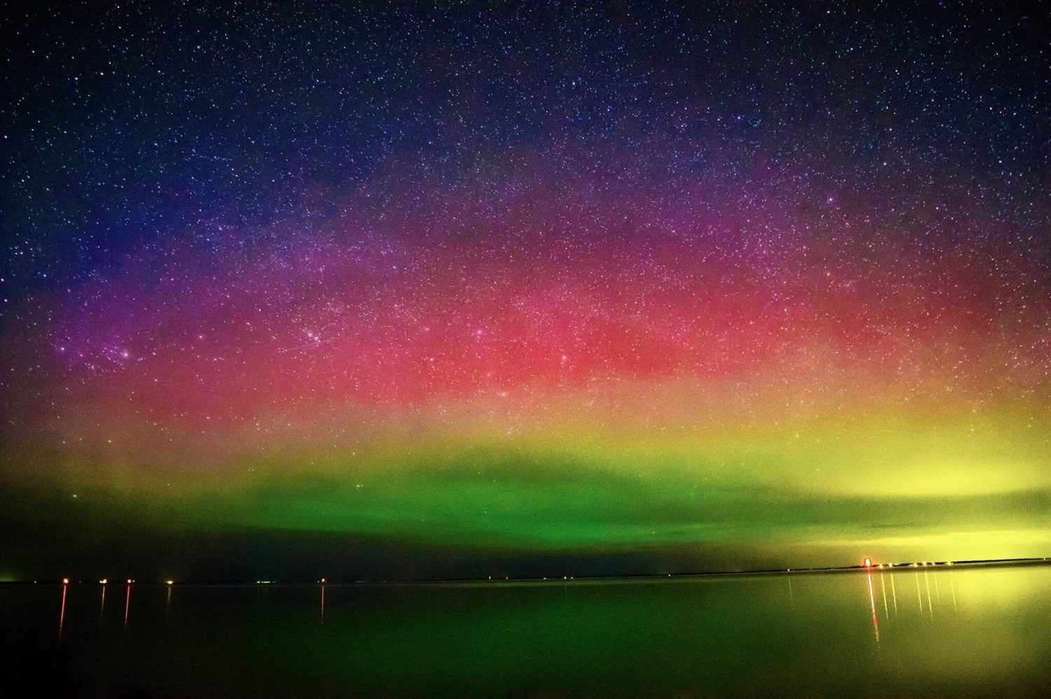 red and green Northern Lights over Wilderness State Park near Headlands Dark Sky Park