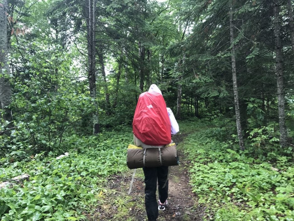 backpacker with red rain guard
