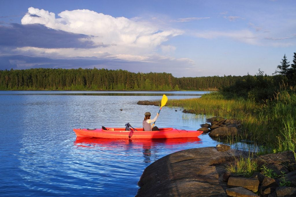 woman kayaking in minnesota national parks