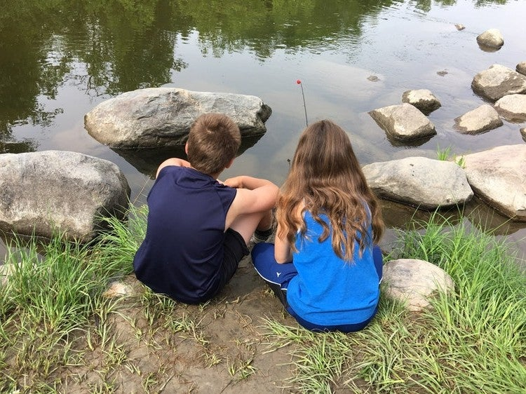 two young kids look for turtles in turtle river state park