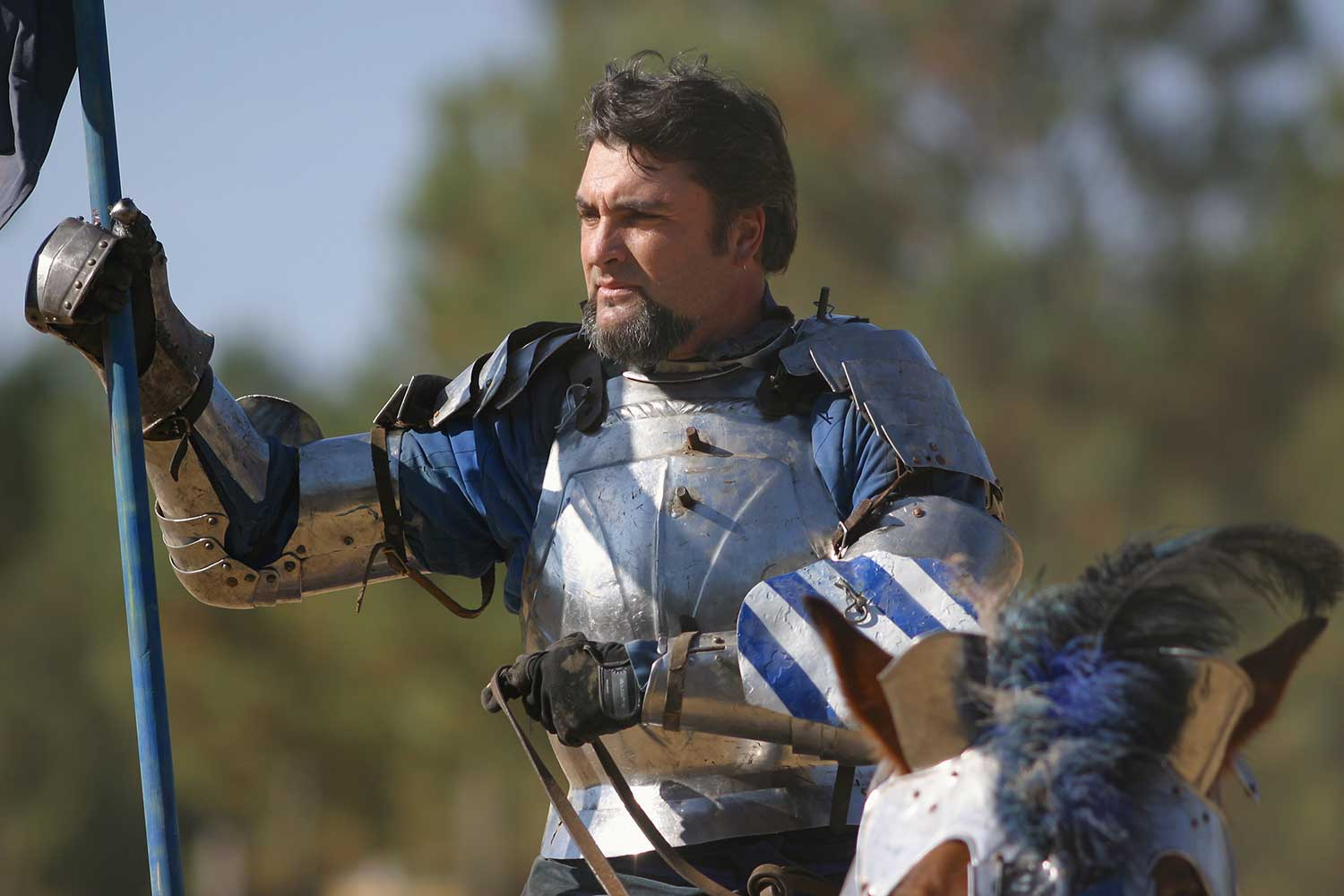 knight with a joust riding a horse at the louisiana renaissance festival
