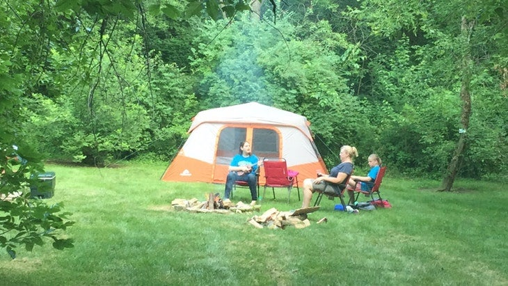 3 campers at a grassy campsite near the pictured rocks in iowa