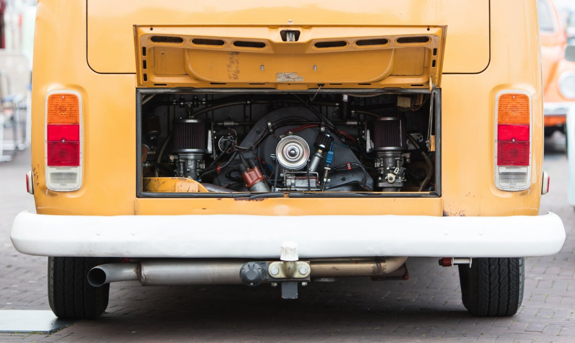 rear engine in a vintage yellow campervan