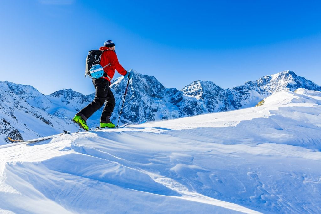 Man skiing on top of a mountain