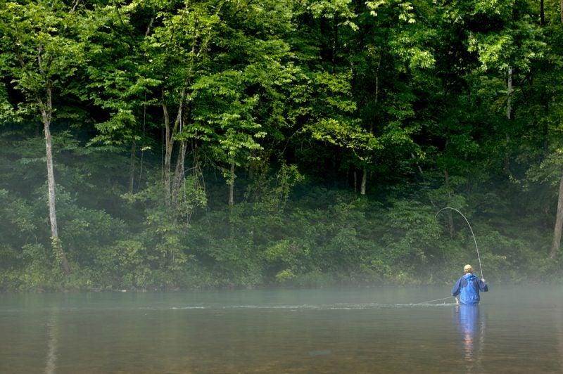 angler in a missouri river