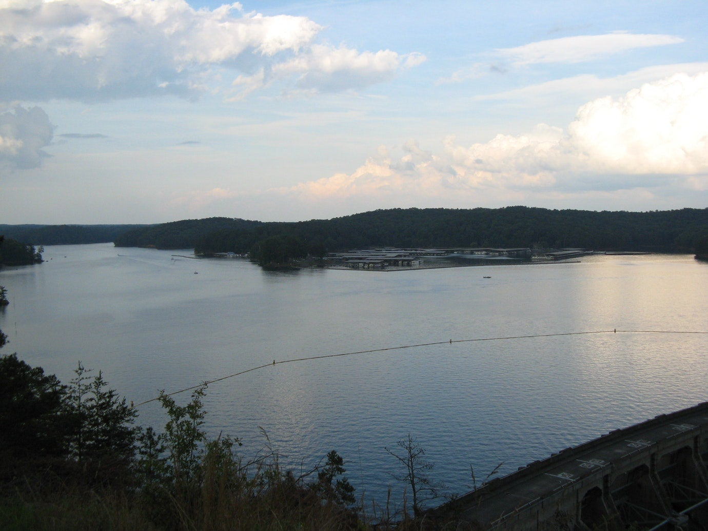 panoramic view of still waters of Lake Allatoona at dusk