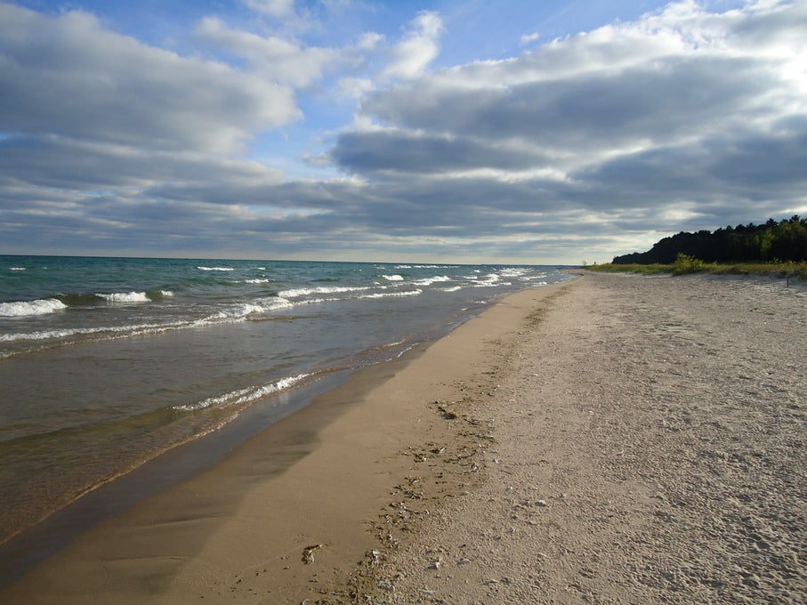 a rocky shoreline in the winter on wisconsin's north shore