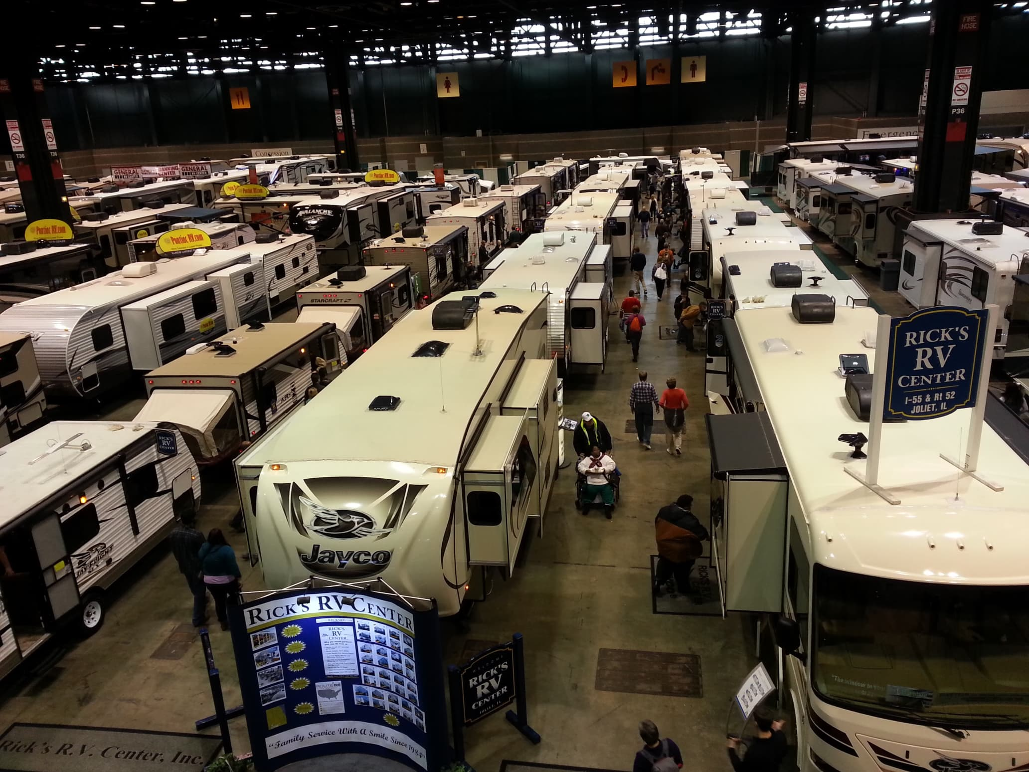 RVs lined up for sale at a trade show