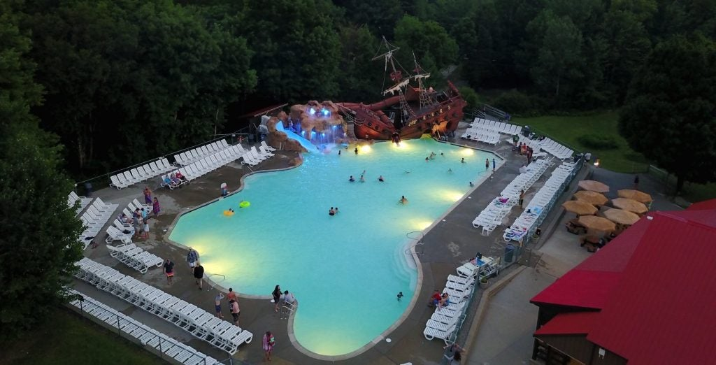 a moose hillock resort pool from above at night
