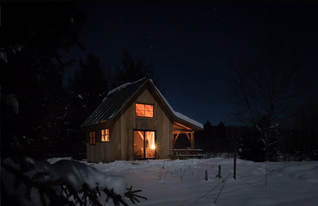 a vermont cabin at night in the snow