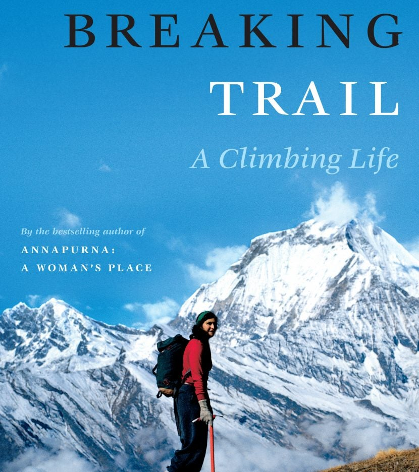 female hiker in red treks up mountainside on breaking trail book cover