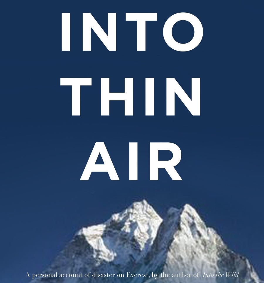 into thin air book cover with dark sky and mountain