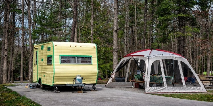 vintage trailer and day use tent in a smoky mountain campsite