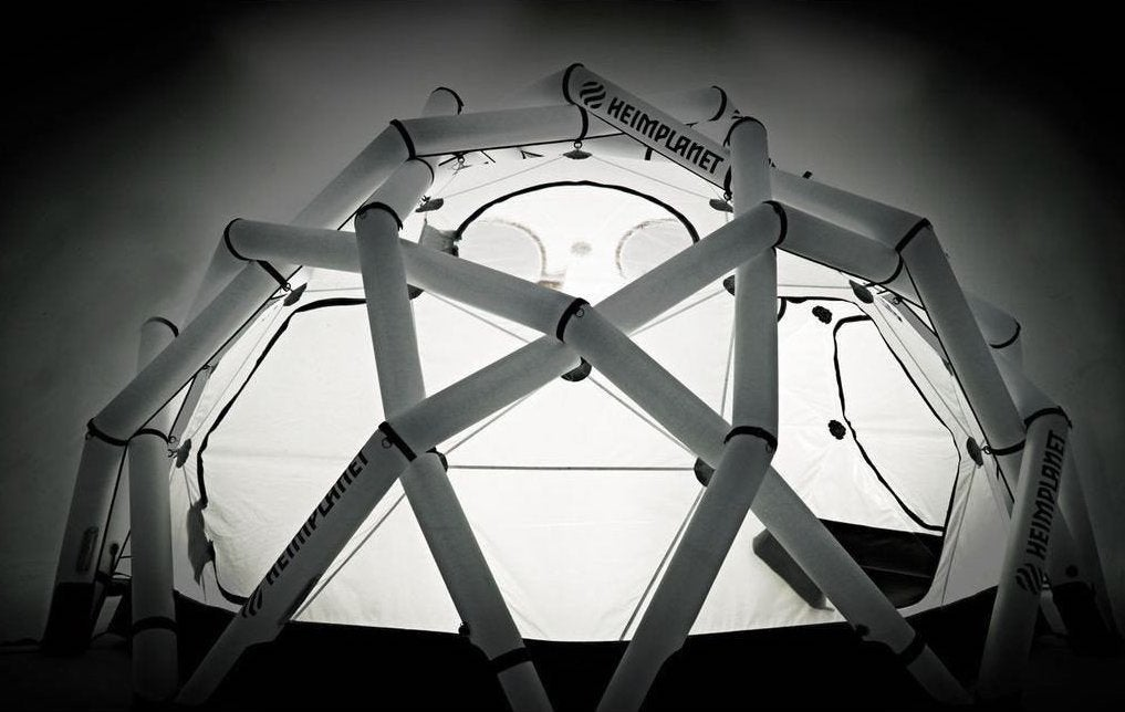 white heimplanet inflatable tent illuminated from the inside