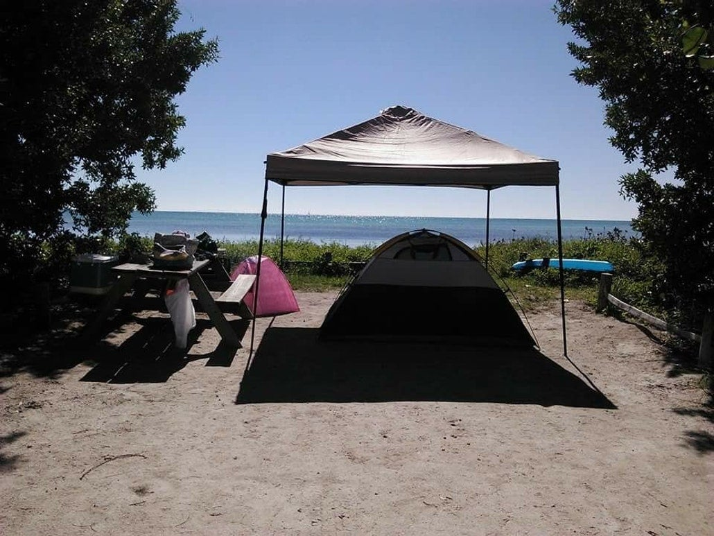 a tent under a canopy on a waterfront key west camping site