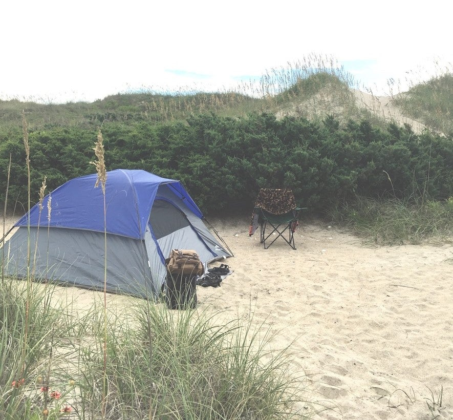 a tent in the sand at an Outer Banks camping site