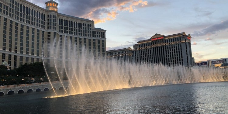 fountains of Bellagio as seen from the vegas strip before sunset