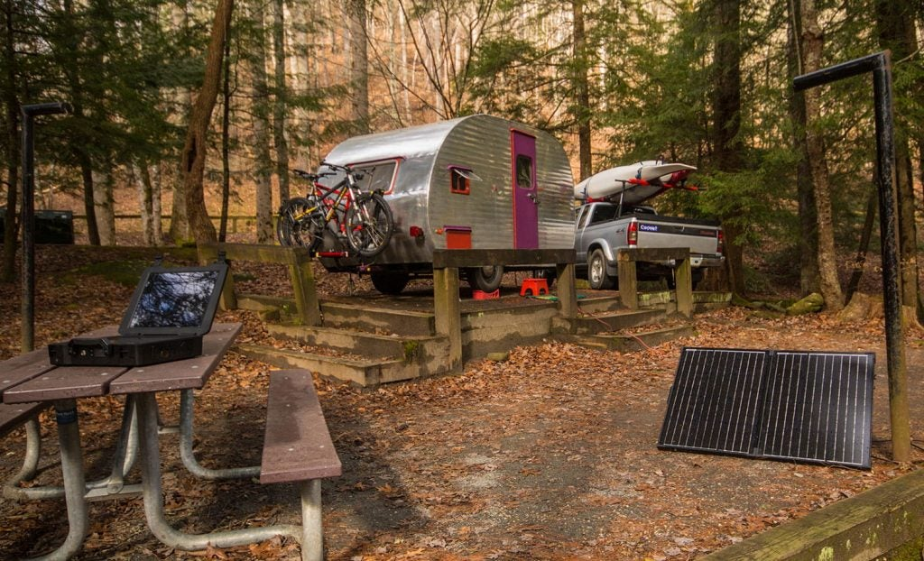 a solar powered system on the ground at an rv campsite