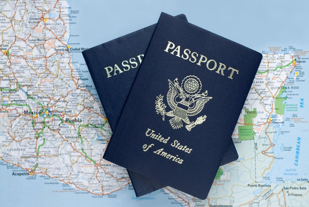 Passport laid upon a map of Mexico
