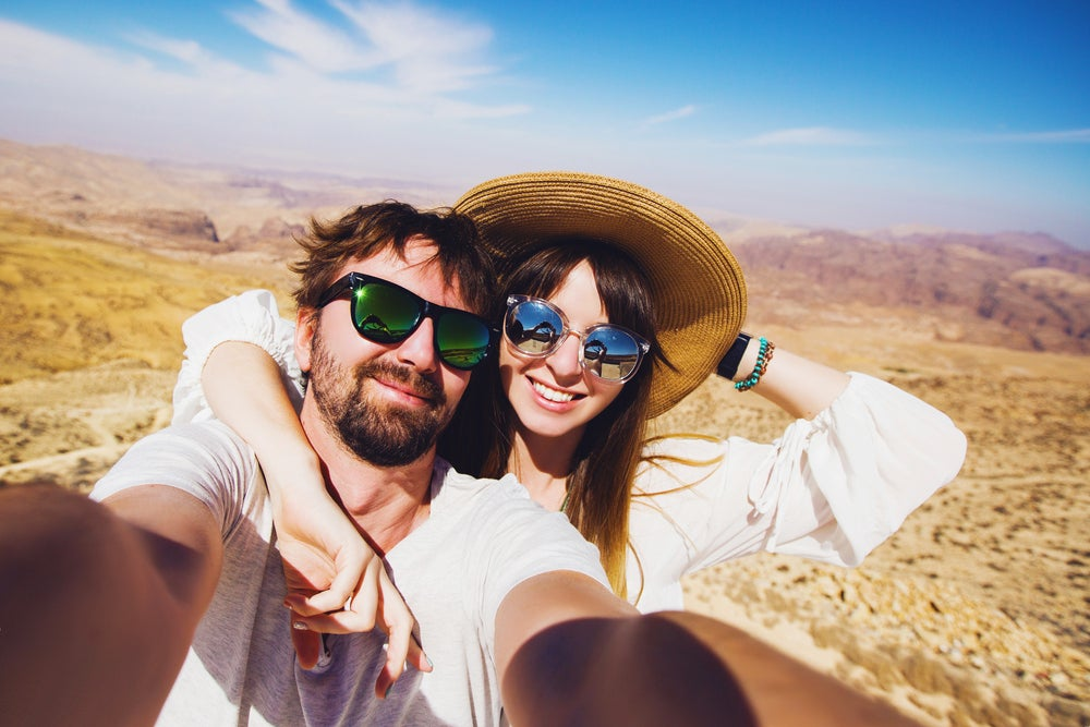 A happy couple enjoying Big Bend camping with sunglasses on