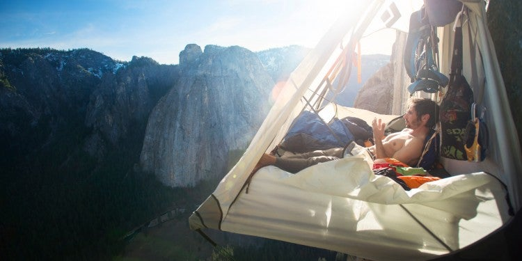 a climber in a suspended hammock seen in a still from a movie showing at the wild & scenic film festival