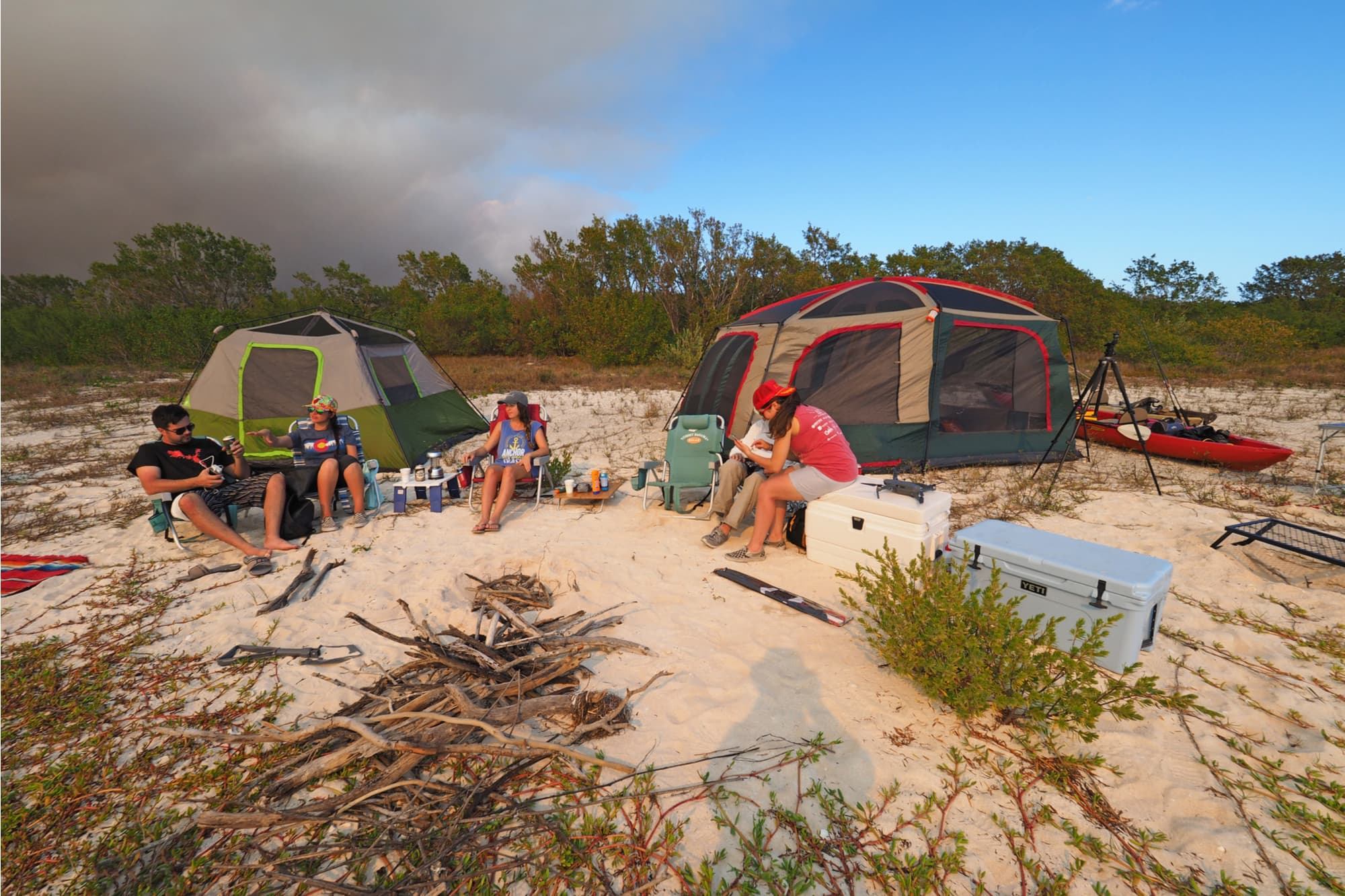 campers hanging out on the beach
