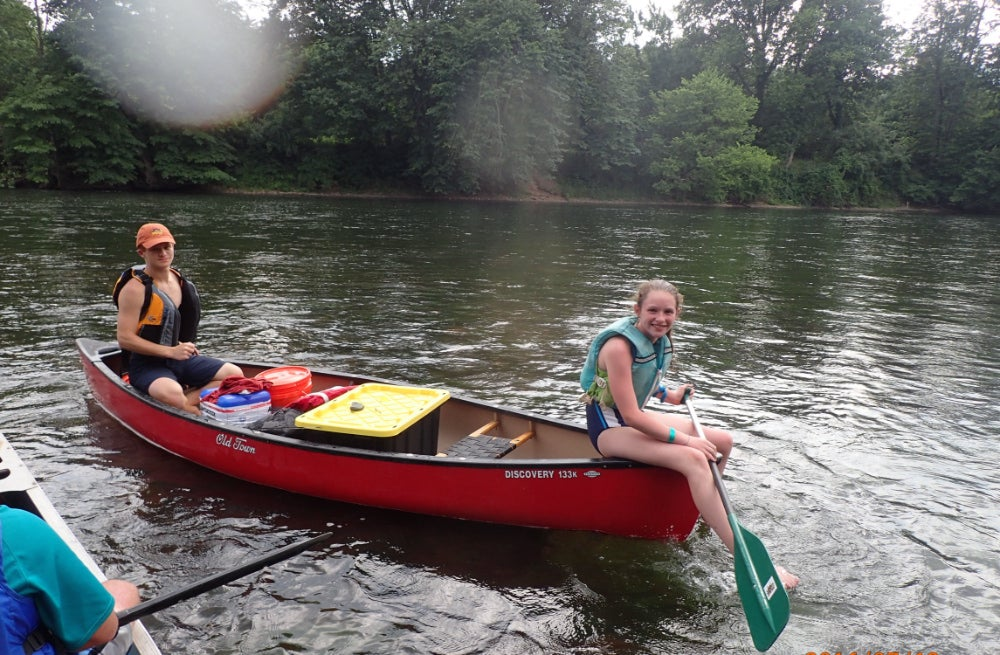 Two teens in a red canoe on the Shenandoah River