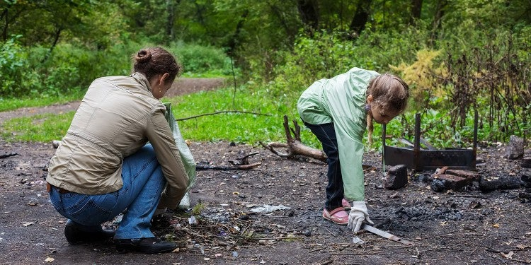national park volunteers clean up a campsite following the government shutdown