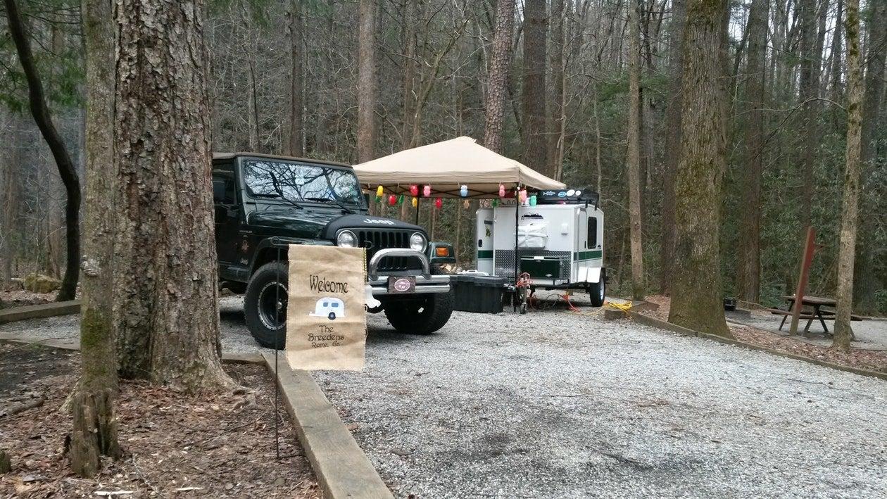 a truck in a festive campsite in the woods