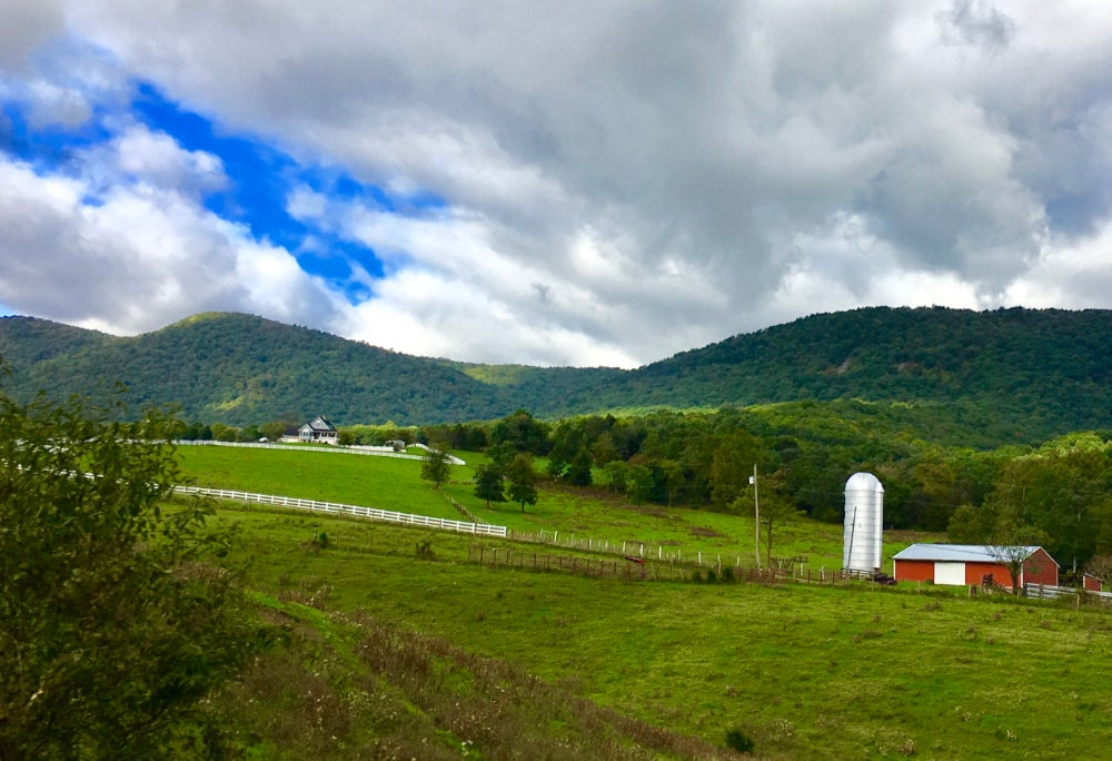 View of farmhouse and small mountains near Luray KOA