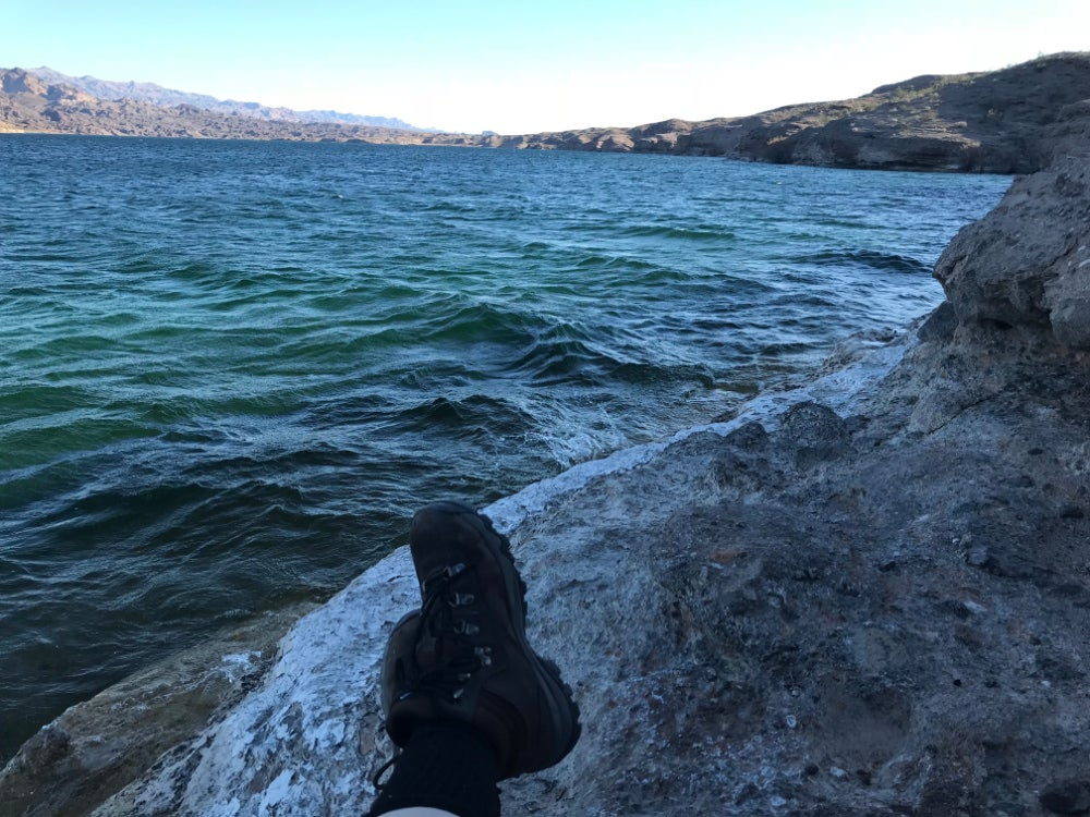 Photo of a pair of hiking boots resting near the Colorado River, near Nelson's Landing in Nevada