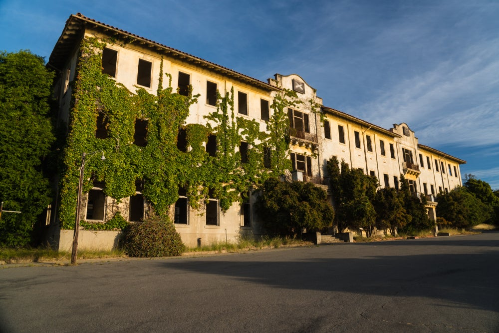 A three story building covered in ivy on Angel Island