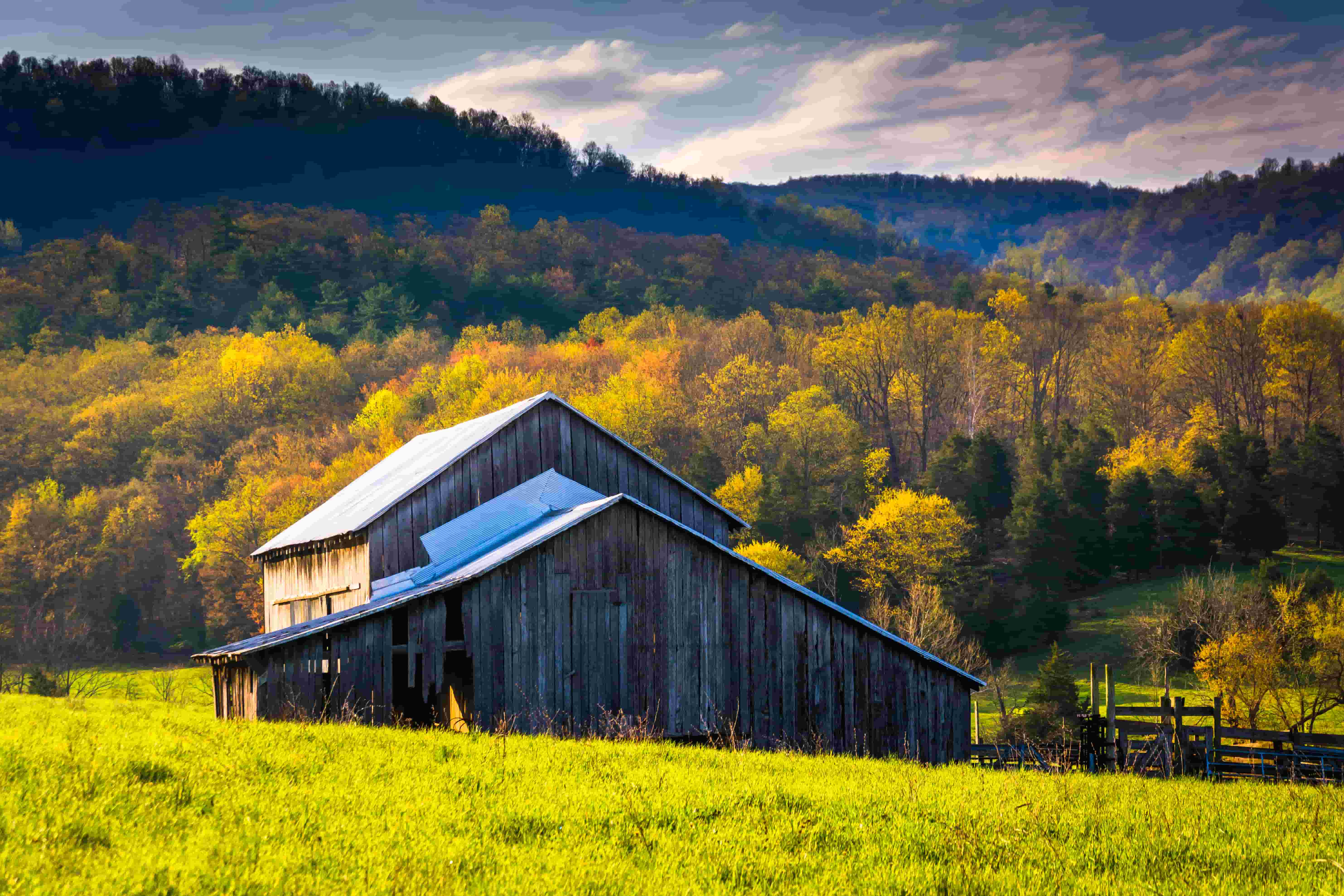A Farmhouse in the foreground in Virginia's Shenandoah Valley, with hills behind it