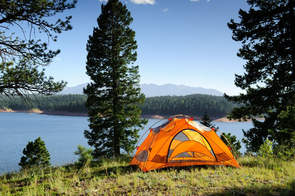 Panoramic view of Fish Lake in Utah with orange tent in foreground