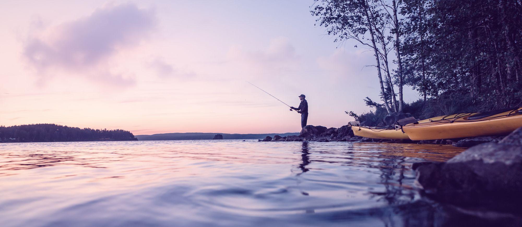 Fisherman casting his line on Fish Lake, Utah
