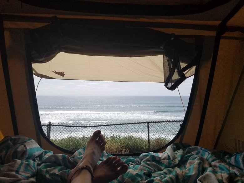 a photo of the california beach taken from inside a tent