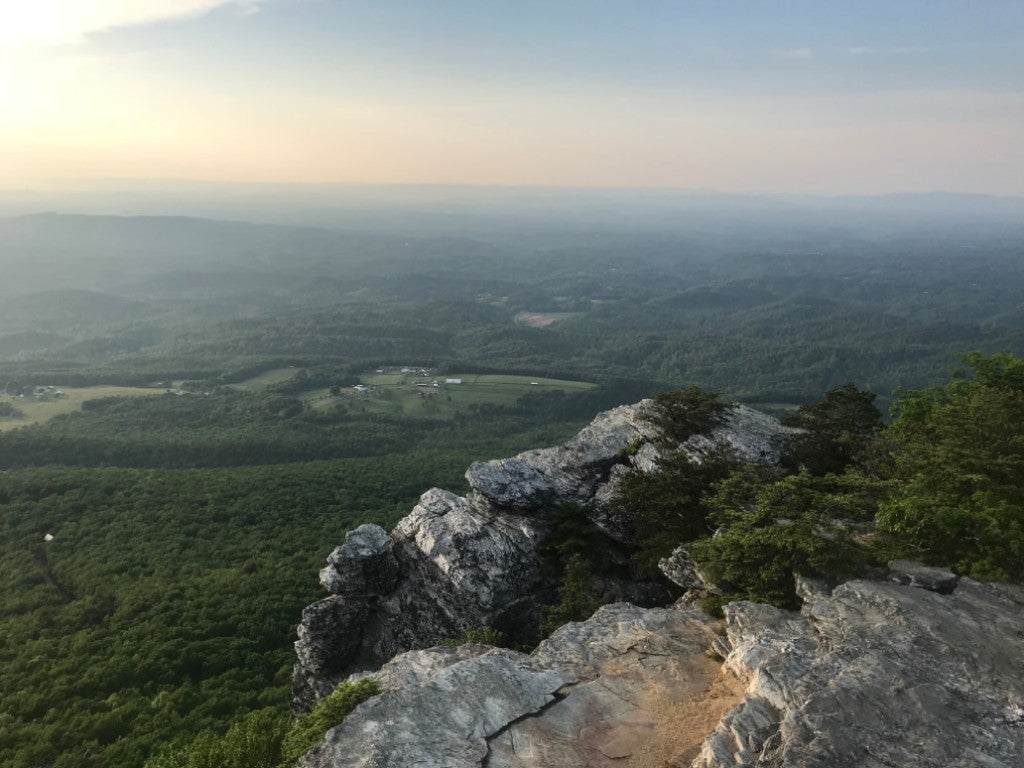 a panoramic view of the valley surrounding north carolina's Hanging Rock State Park at sunset