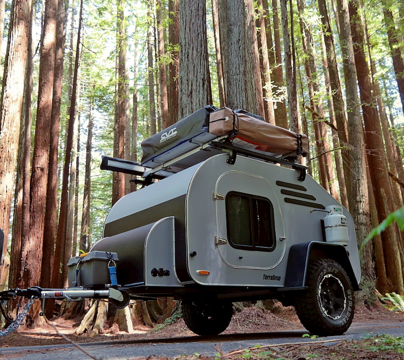 The Terradrop all terrain trailer equipped with a rooftop tent being towed through the forest
