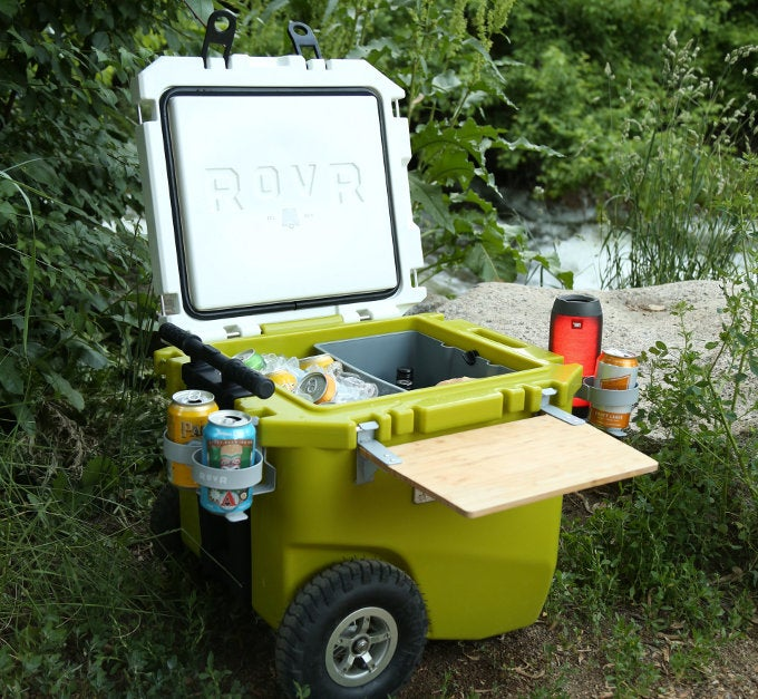 Rovr cooler with drinks in it and trees surrounding cooler