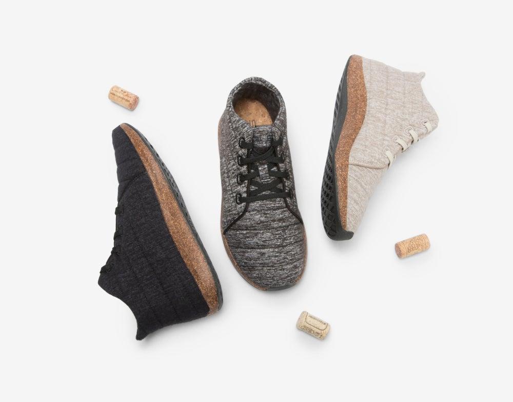 three individual Jasper Wool Eco Chukka eco-friendly shoes next to three corks